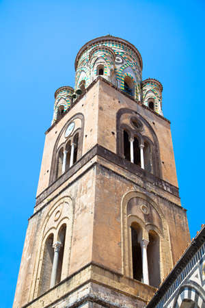 the bell tower of Amalfi Cathedral, Italy. 9th-century Roman Catholic structure. It is dedicated to the Apostle Saint Andrew. photo