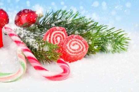 Christmas Decoration with Candy Canes, on a fake snow background. photo