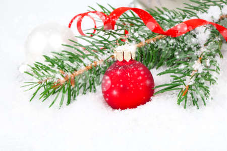 Christmas balls and fir branches on a snow background. photo