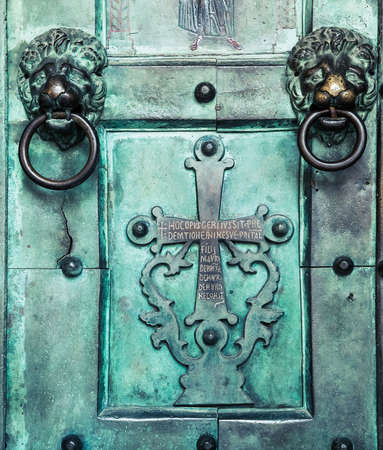 Holy Cross, old, door, Amalfi Cathedral, Italy. 9th-century Roman Catholic structure. It is dedicated to the Apostle Saint Andrew. photo