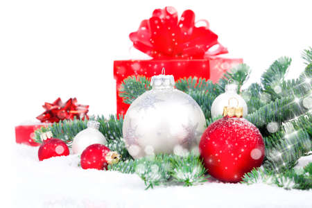 christmas red gift with festive decorations on snow background photo