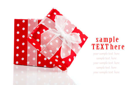 red gift box with  bow on white background photo