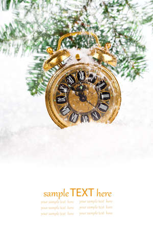vintage christmas decoration - antique golden clock and fir-tree in snow. with copy space, on white background photo