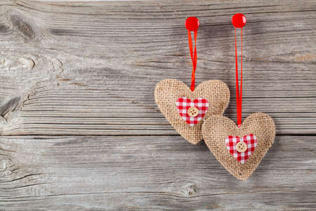 hearts with red bow, on wooden background photo