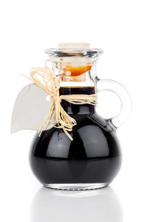 ardent: maple syrup in glass bottle or herbal syrup, ardent drink, mixture, with heart label. on white . Stock Photo