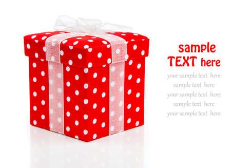 red gift box, polka dots on white . photo