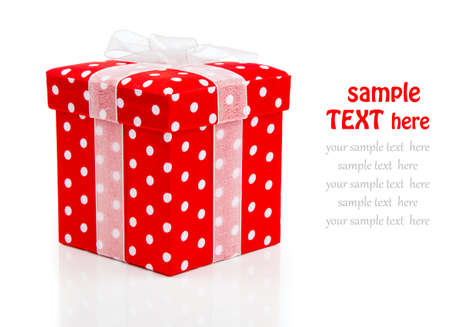 red gift box, polka dots on white . photo