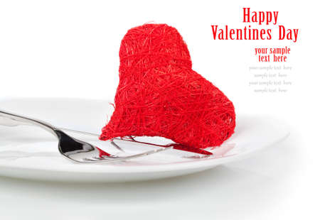 Red heart with fork. Concept image for Valentine dinnerlove foodlove cooking etc. Copy space. photo