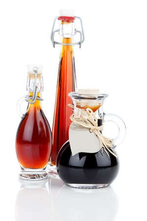 maple syrup in glass bottle or herbal syrup, ardent drink, mixture, with heart label. on white background. photo