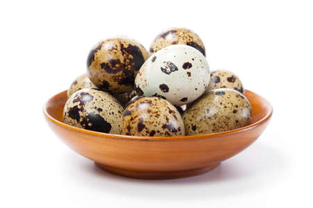 Fresh quail egg in bowl  isolated on white background  photo