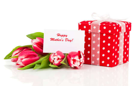 giftbox: beautiful tulips with red polka-dot gift box. happy mothers day, romantic still life, fresh flowers