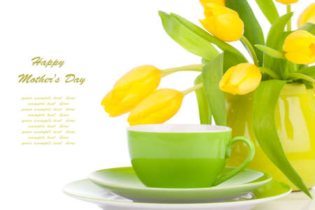 yellow tulips flowers with cup tea, on a white background.  photo