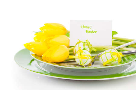Easter eggs and blank for text in a plate, on a white background