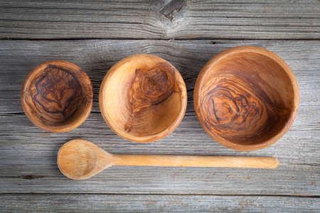cooking utensils: Wooden kitchen utensils on wooden background