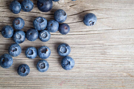 Fresh Blueberries on wooden Background photo