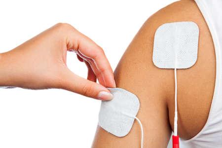 electrode: electrodes of tens device on shoulder, tens therapy, nerve stimulation