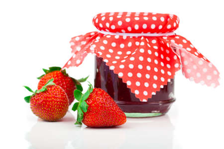 Strawberry jam and fresh berries isolated on white photo