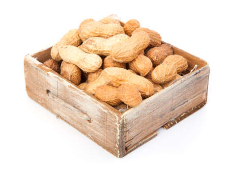 Peanuts in the old box, on white background photo