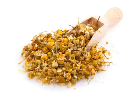 thirstiness: a pile of dried chamomile flowers on a white background