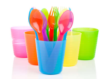 bright plastic tableware, isolated on white background photo