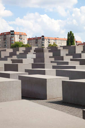 jews: The Memorial to the Murdered Jews of Europe on September in Berlin, Germany  The site contains 2,711 concrete slabs and was designed by Peter Eisenman and Buro Happold