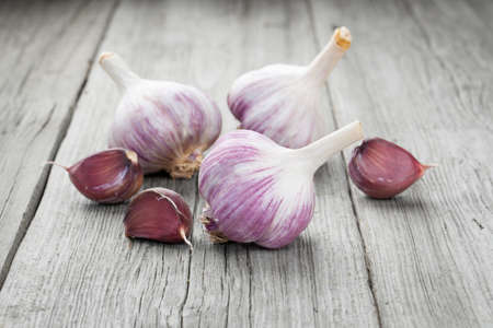 garlic clove: Organic garlic whole and cloves on the wooden background