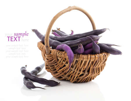 pinto: Red bean pods in wicker basket over white background