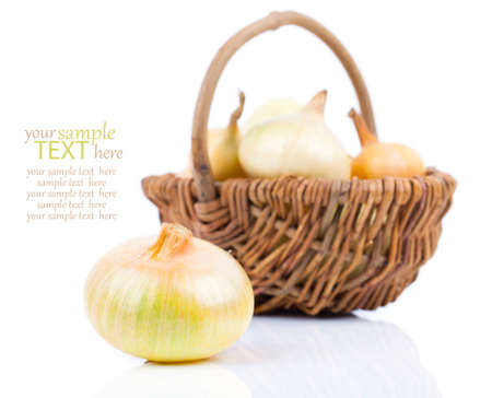 onion bulb in wicker basket, isolated on white background photo