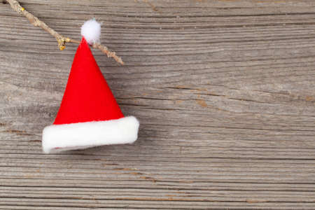 Single Santa Claus red hat on wooden background photo