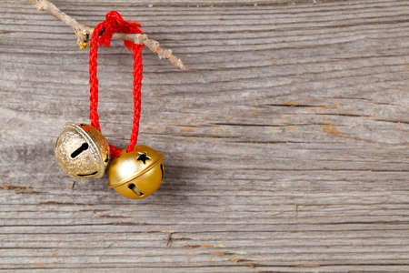 Christmas bells on wooden background photo