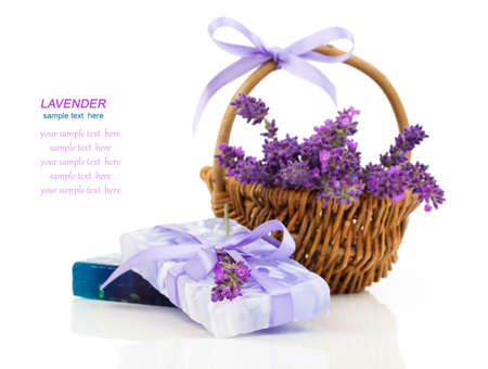 Natural handmade lavender soap and oil with fresh lavender on white background photo