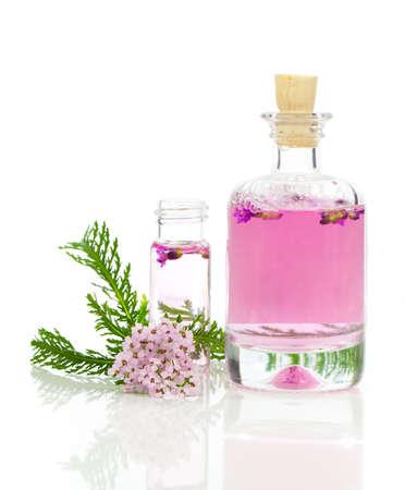 Yarrow herbal tincture, with fresh flowers Achillea millefolium. photo
