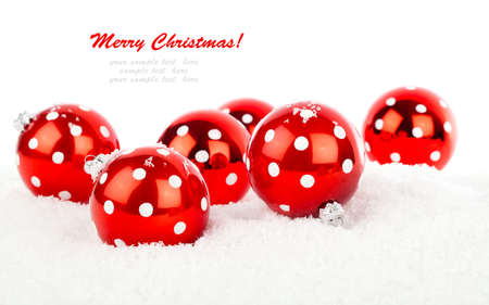 red polka dot Christmas bauble, isolated over white photo