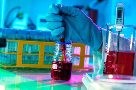 biopsy: researchers work in modern scientific lab. Preparation of hazardous solution