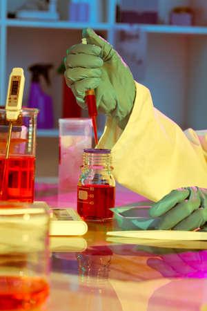 nitril: researchers work in modern scientific lab. Preparation of hazardous solution