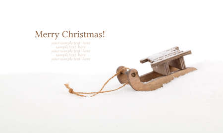 Old vintage wooden sled on white background photo