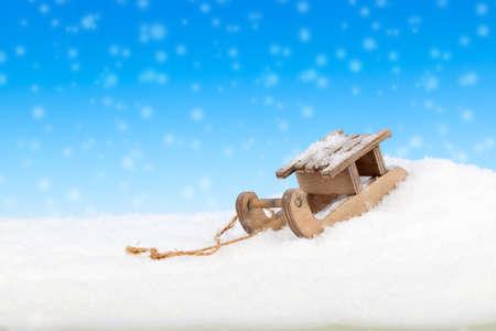 Old vintage wooden sled on blue background photo