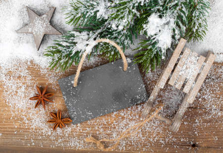 Christmas decoration over snow, wooden background photo