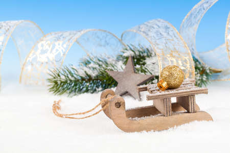 Christmas decoration over snow, blue background photo