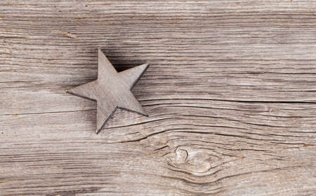 xmas background: Old xmas star on wooden vintage background