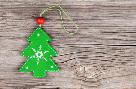 xmas tree on wooden vintage background photo