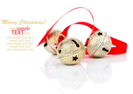 Christmas jingle bell with red ribbon, on white photo