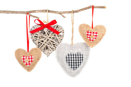 heart hanging on a tree branch, isolated on white background photo