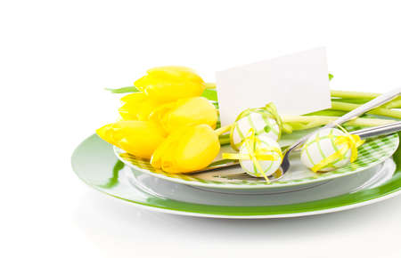 Happy Easter, easter table place setting, with sample greeting or copy space for your text here.