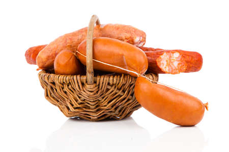 Smoked sausage on a string in basket. Isolated on white background photo