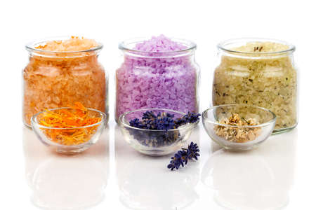 various kinds of bath salt with flowers, isolated on white background