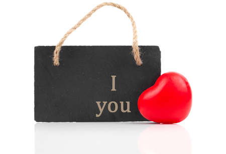 red heart with blackboard, on white wooden background photo