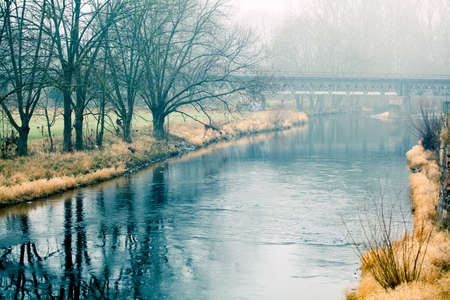 Beautiful morning mist landscape near a small river. photo