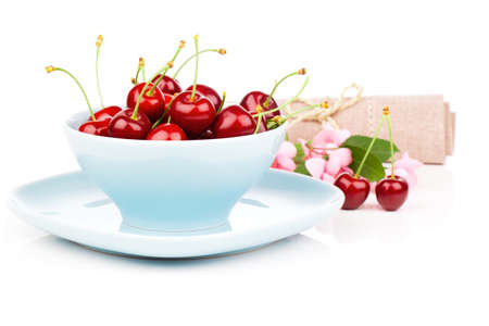 strew: Bowl full of cherries isolated on white background