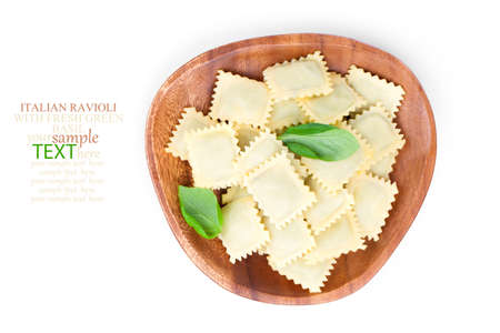 perle: Homemade pasta ravioli with fresh basil, isolated over white background.